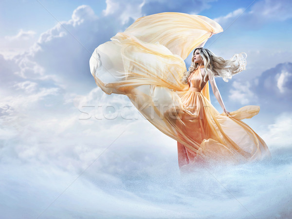 Dreamy image of a beautiful young lady in the clouds Stock photo © konradbak