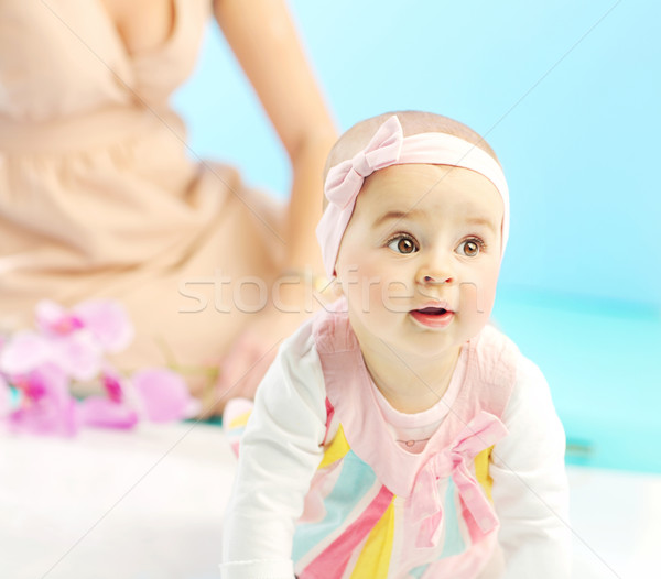 Cute little girl under mom's sight Stock photo © konradbak