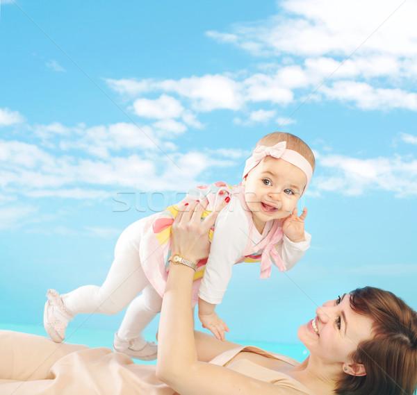 Atractivo mamá minúsculo hija madre Foto stock © konradbak