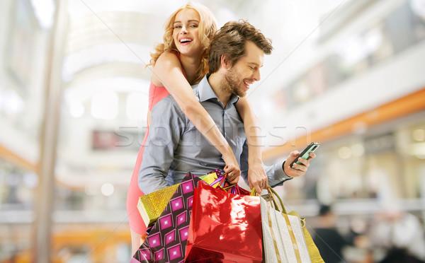 Elragadtatott pár vásárlás fiatal pér nő férfi Stock fotó © konradbak