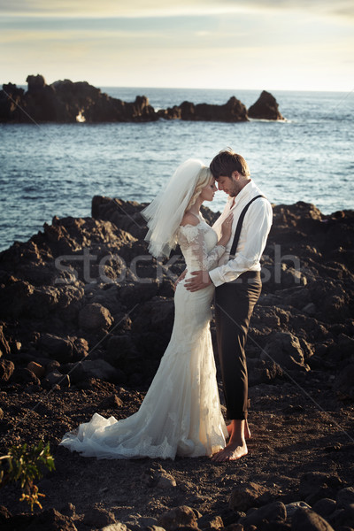 Young marriage couple over the ocean Stock photo © konradbak
