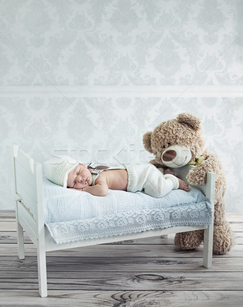 Little sleeping baby and the teddy bear Stock photo © konradbak