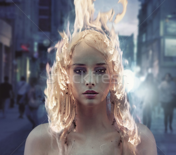 Conceptual portrait of a lady with burning hair Stock photo © konradbak