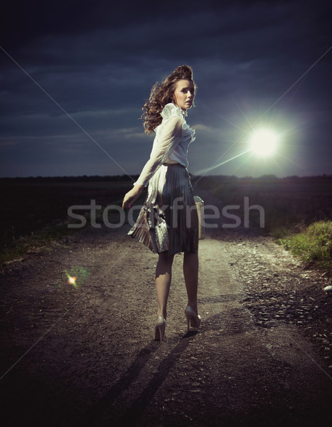 Beautiful woman walking away Stock photo © konradbak