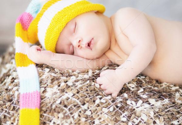 Picture of sleeping baby with woollen cap Stock photo © konradbak