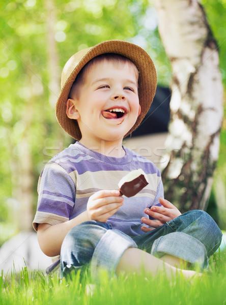 Satisfeito pequeno menino sorvete criança cara Foto stock © konradbak