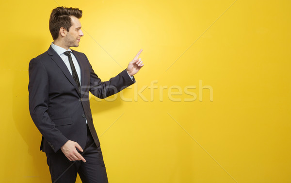 Young manager indicates something crucial Stock photo © konradbak
