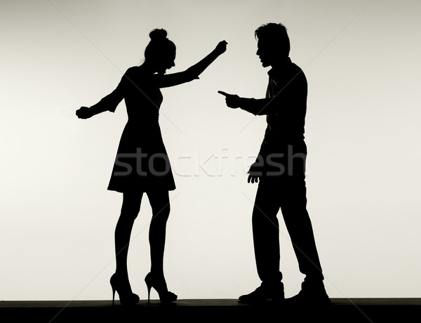 Two fighting silhouettes of the marriage couple Stock photo © konradbak