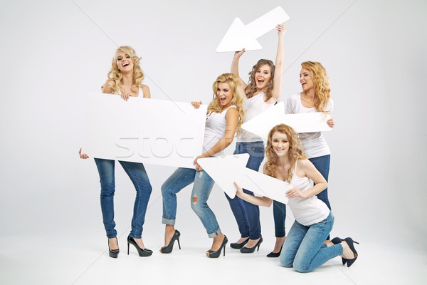 Alluring women promoting the sale Stock photo © konradbak