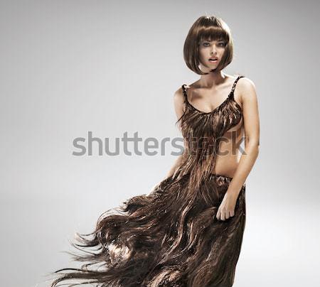 Conceptual portriat of the woman wearing dress made of hair Stock photo © konradbak