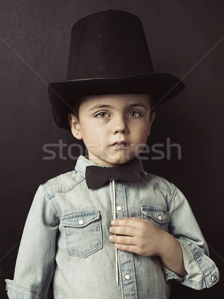 Portrait of a little serious gentleman Stock photo © konradbak