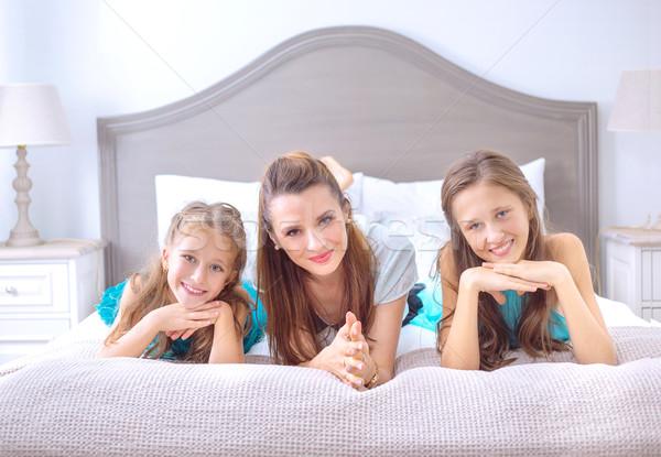 Portrait of the modern happy family Stock photo © konradbak