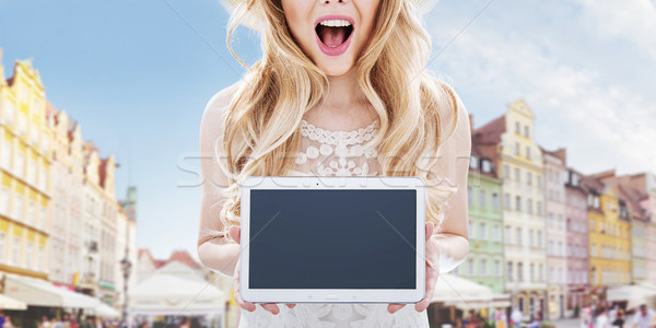 Urban ladnscape - pretty woman holding a tablet Stock photo © konradbak