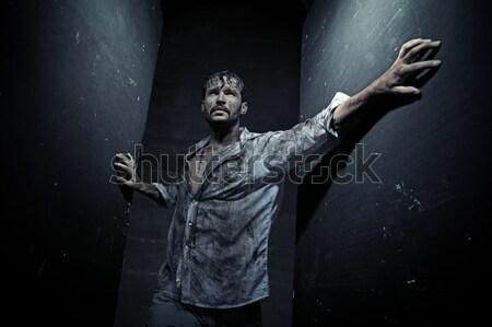 Handsome man wearing dirty clothes Stock photo © konradbak