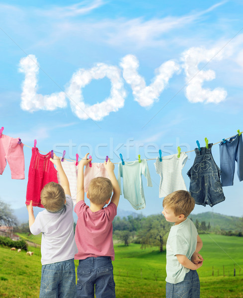 Cute brothers making a laundry Stock photo © konradbak