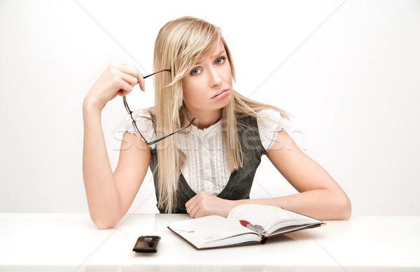 Young businesswoman thinking at work Stock photo © konradbak