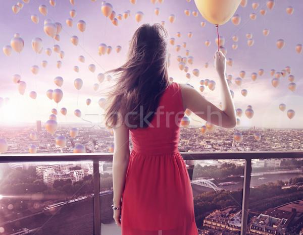 Young woman staring at thousands of the balloons Stock photo © konradbak