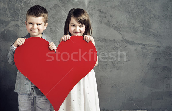 Smiling kids holding a heart Stock photo © konradbak