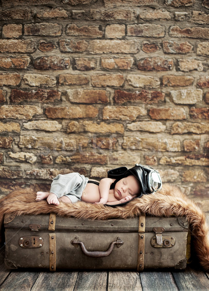 Little pilot sleeping on the suitcase Stock photo © konradbak