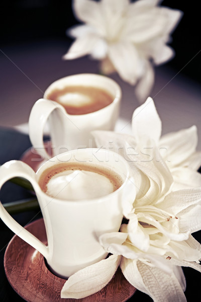 Stock photo: cups of milk coffee with flowers