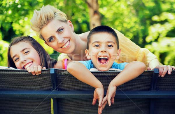 Calm day of the satisfied family Stock photo © konradbak