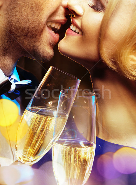Closeup portrait of a couple drinking a champagne Stock photo © konradbak