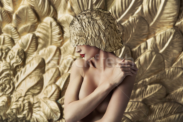 Conceptual portrait of a seductive lady wearing feather hat Stock photo © konradbak