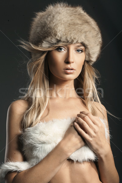 Fashion style photo of a young blonde Stock photo © konradbak