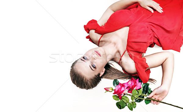 Pretty blonde holding a rose - isolated portrait Stock photo © konradbak