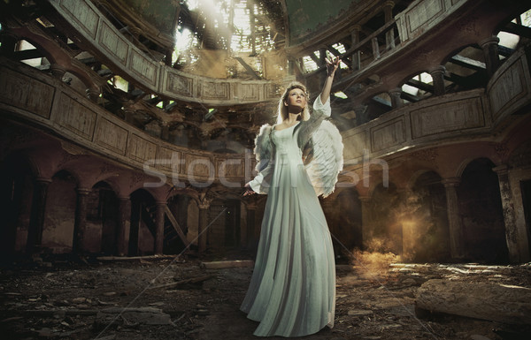 Beautiful angel in old, abandon place Stock photo © konradbak