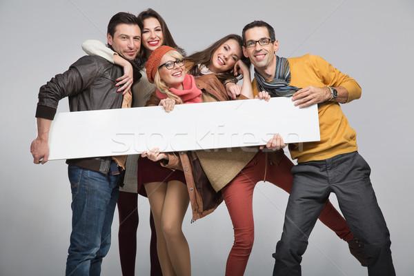 Group of friends want to advertise Stock photo © konradbak