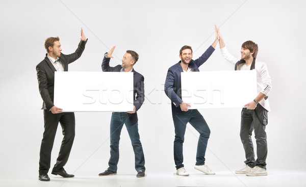Groep vrienden vrolijk business ruimte mannen Stockfoto © konradbak