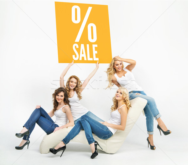 Picture of attractive women promoting sale Stock photo © konradbak