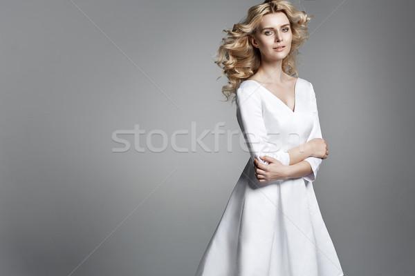 Csinos fiatal nő fürtös nő esküvő fény Stock fotó © konradbak