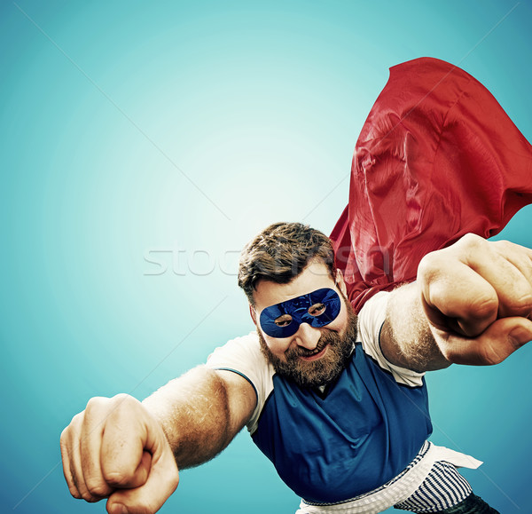 Plump superheroe flying over the city Stock photo © konradbak