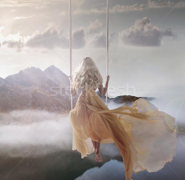 çekici bayan oturma salıncak üzerinde Stok fotoğraf © konradbak