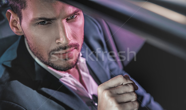 Handsome man posing in the limousine Stock photo © konradbak