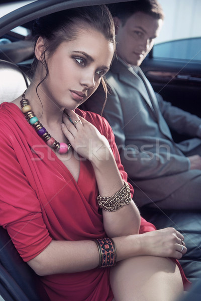 Handsome elegant couple traveling a luxury vehicle Stock photo © konradbak