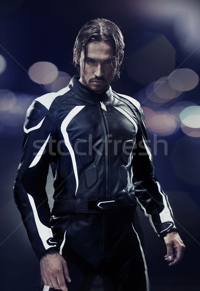 Stylish man wearing motorbike uniform Stock photo © konradbak