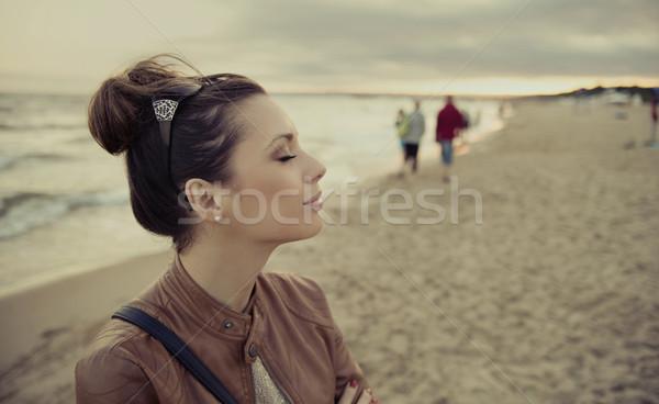 Nice photo of brunette girl in casual appearance Stock photo © konradbak