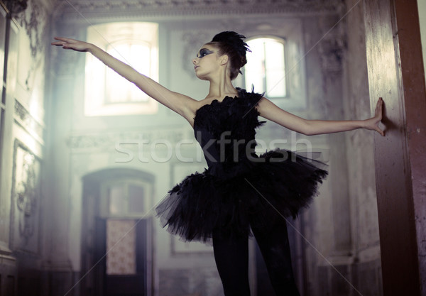Black swan ballet dancer in move Stock photo © konradbak