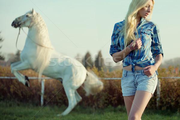Csábító szőke nő szépség fenséges ló virágok Stock fotó © konradbak