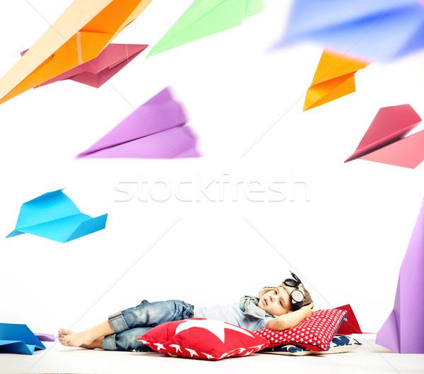 Little pilot observing plenty of paper planes Stock photo © konradbak