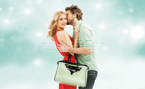 Handsome man kissing his wife Stock photo © konradbak