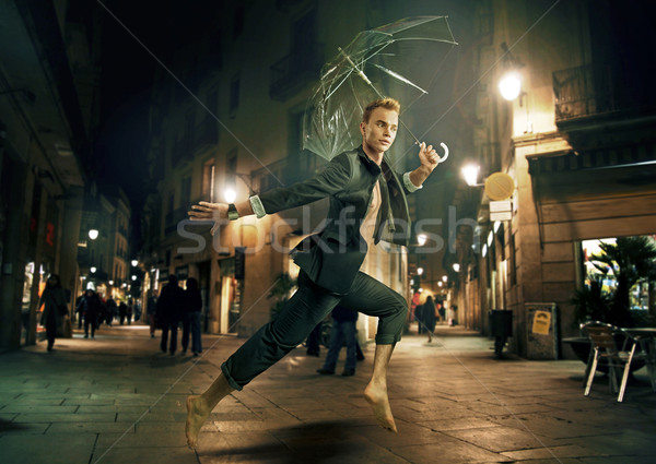 Portrait of a handsome businessman in downtown Stock photo © konradbak
