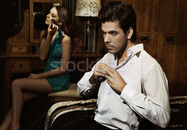 Young handsome couple preparing for the party Stock photo © konradbak