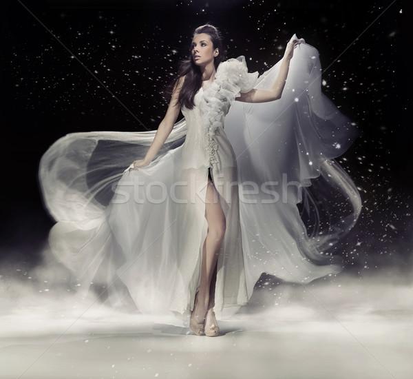érzéki barna hajú nő tánc fehér ruha háttér Stock fotó © konradbak