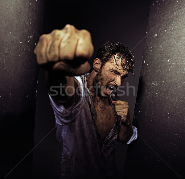 Fighting filthy man with tough nature Stock photo © konradbak