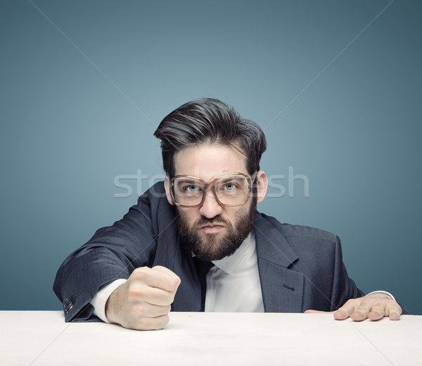 Tough businessman ruling the company Stock photo © konradbak