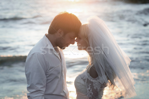 Closeup portrait of young and happy newlyweds Stock photo © konradbak